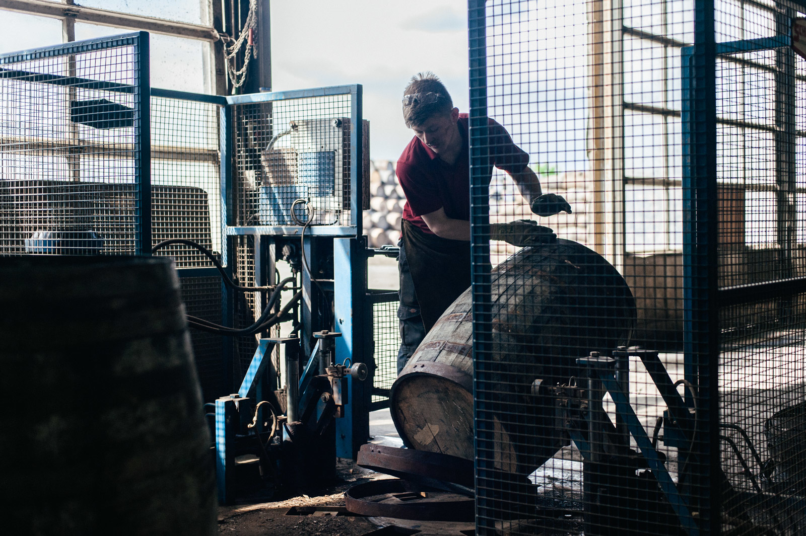 a worker moving a barrel