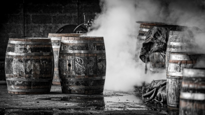 Newly repaired wooden whisky casks being steamed