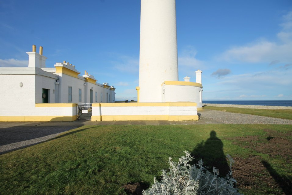 Base of lighthouse with two lighthouse cottages