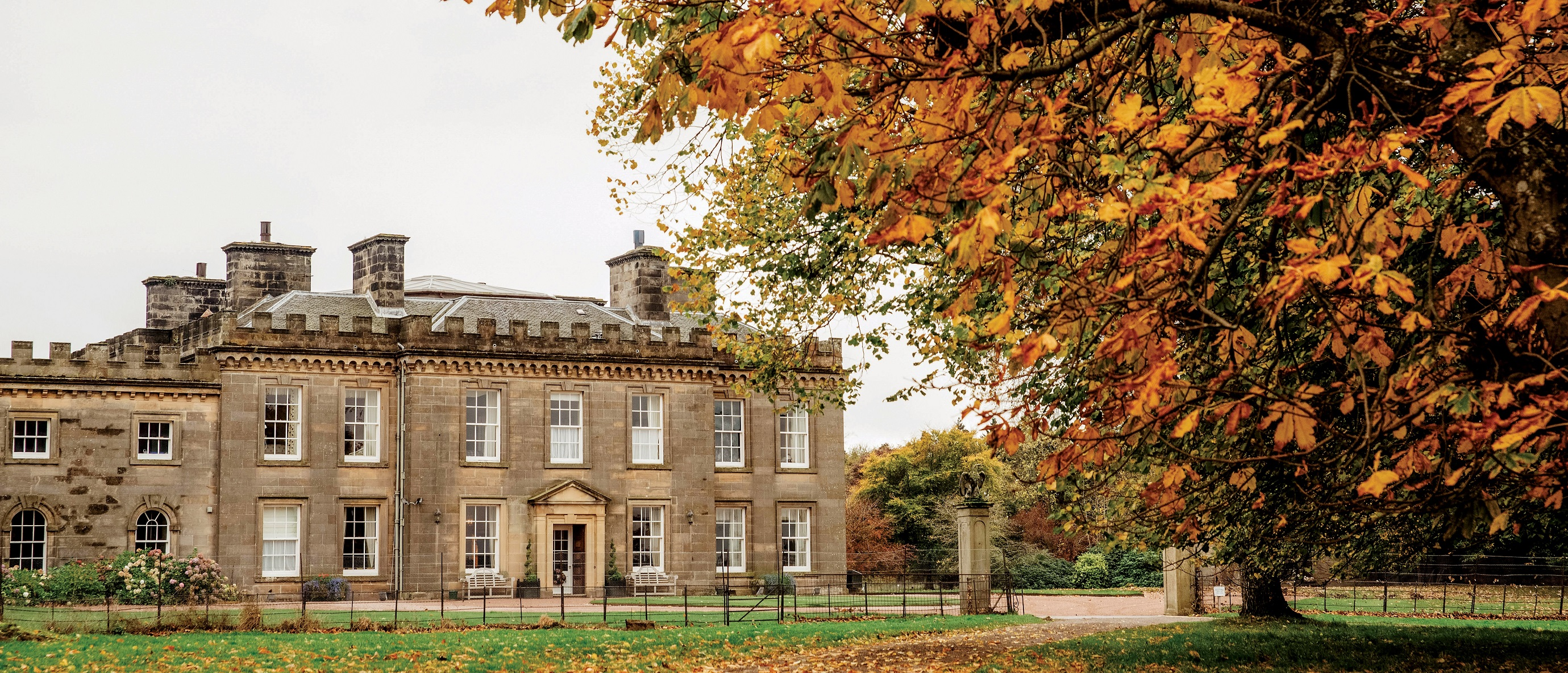 18th century country house, with autumnal trees
