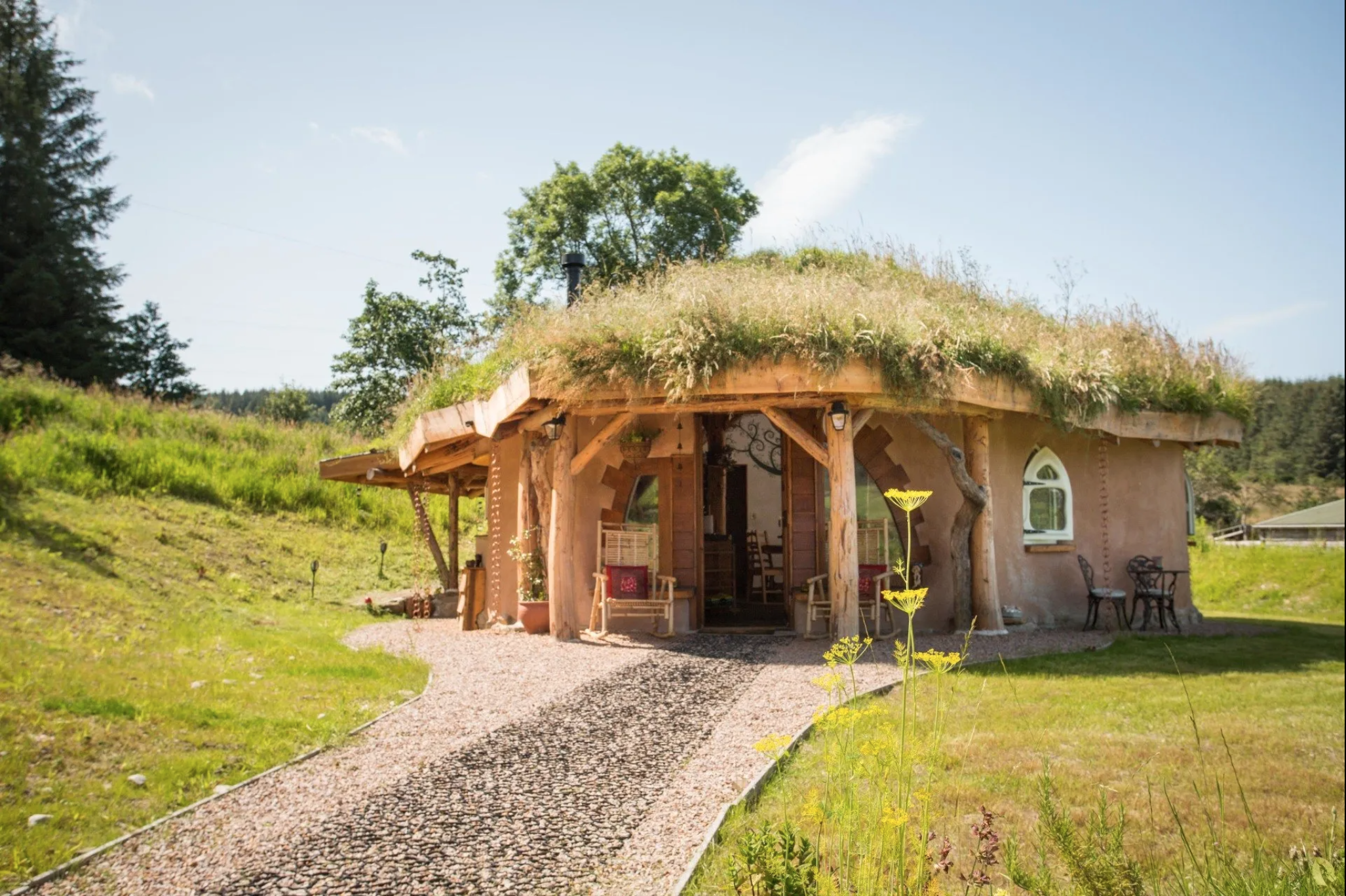 Round wooden cabin with turf roof
