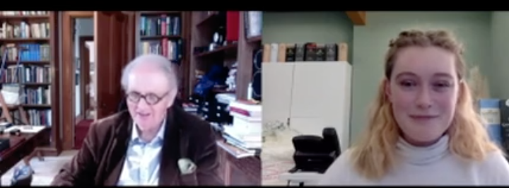Alexander McCall Smith in his study, talking on a video call to a young woman