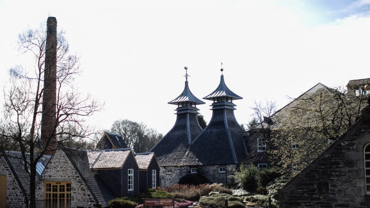 View of Strathisla Distillery, with its distinctive pagoda roof, and surrounding garden