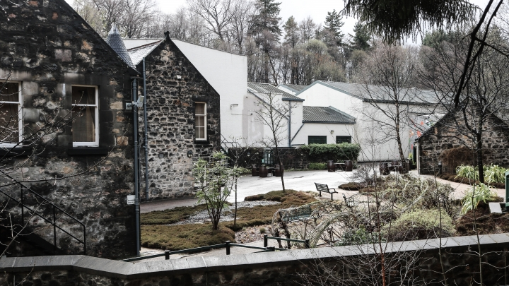 A Scotch distillery during winter, with frost and snow on the ground